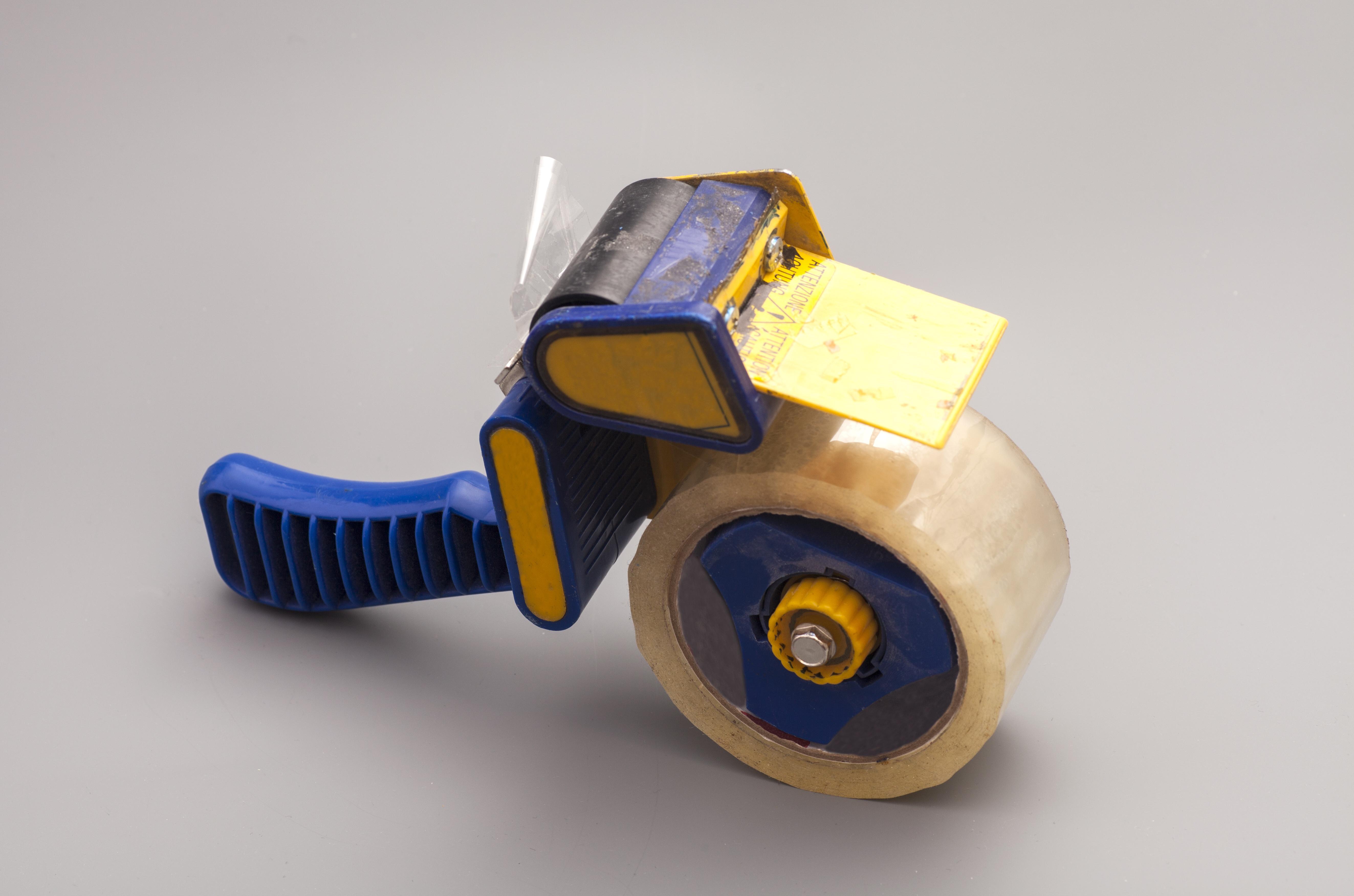 Hand-Held Tape Gun